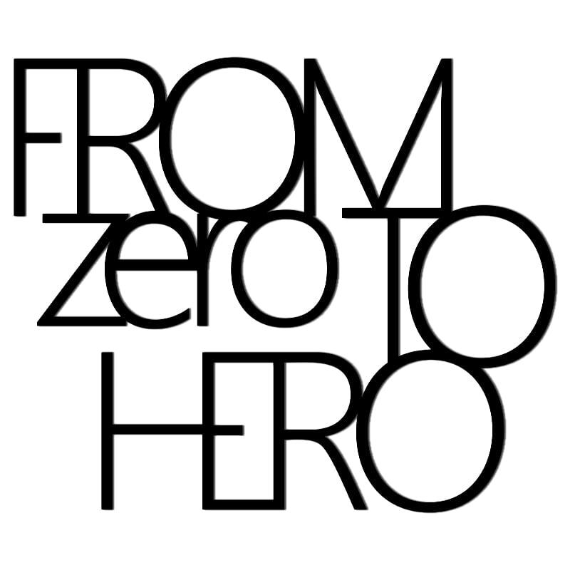 Inschrift an der Wand FROM ZERO TO HERO schwarz